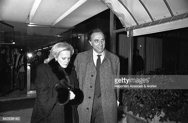 Pippo Baudo , Italian TV host, coming out of a club with his second wife Katia Ricciarelli , famous Italian soprano. Italy, 1980s