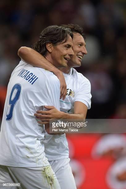 Pippo Inzaghi and Leonardo Nascimento de Araujo celebrate during Andrea Pirlo Farewell Match at Stadio Giuseppe Meazza on May 21 2018 in Milan Italy
