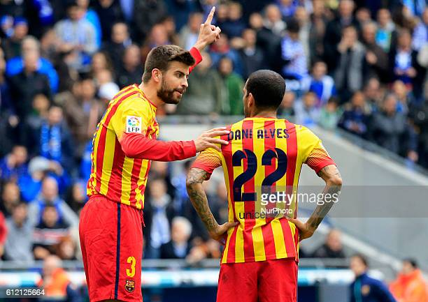 Pique and Dani Alves on in the match between RCD Espanyol and FC Barcelona matchday 31 of La Liga played at CornellaEl Prat Stadium on March 29 2014...