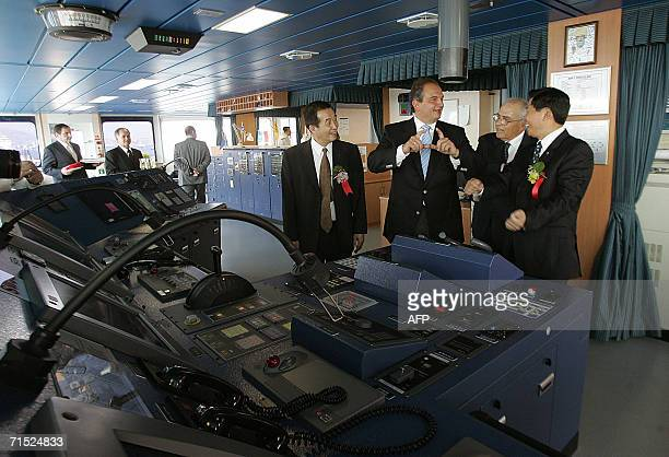 Greek Prime Minister Costas Karamanlis talks with Chinese officials during the launch of the Cosco Hellas a Greekowned container ship built by...