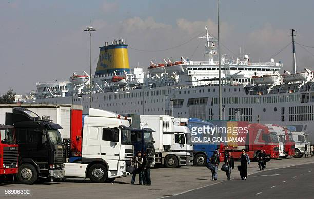 Trucks wait to embark at the Piraeus harbour near Athens 22 February 2006 during the seventh day of a nationwide seamen strike The Greek government...