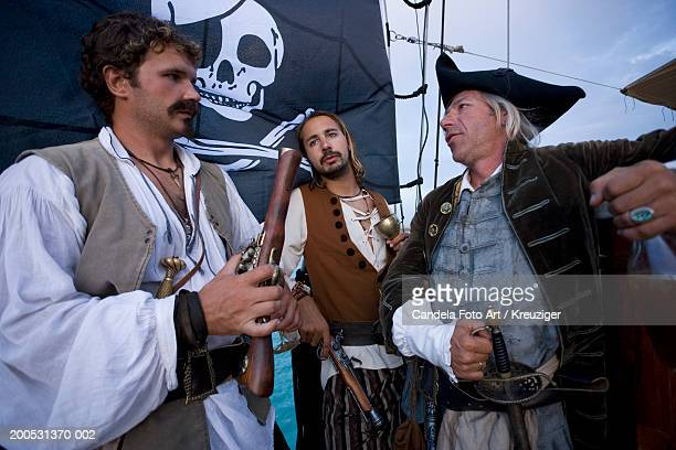 Pirate captain and crew on deck of pirate ship