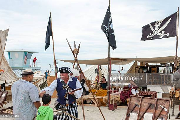 Pirate chats with visitors at the Pirate Invasion festival