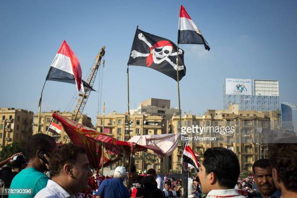 Pirate flag flies on Tahrir square in downtown Cairo as Egyptians gather in big numbers to support in support of the Egyptian military who presented...