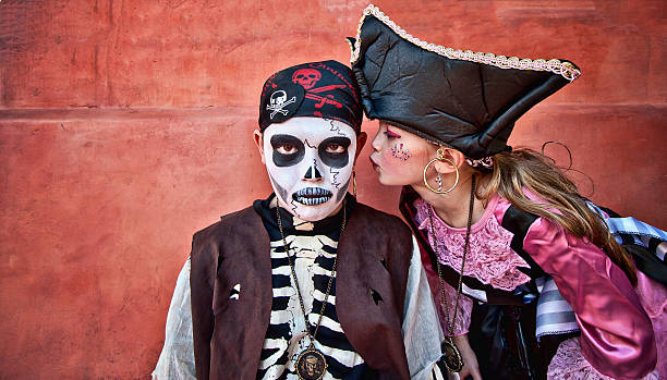 Pirate girl leaning in to kiss pirate boy