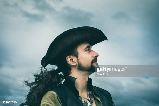 pirate looking at view. dramatic sky - cosplay stock pictures, royalty-free photos & images