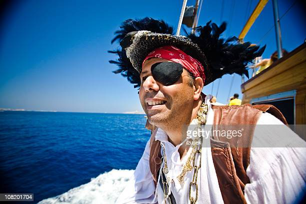Pirate looking in to the distance off ship