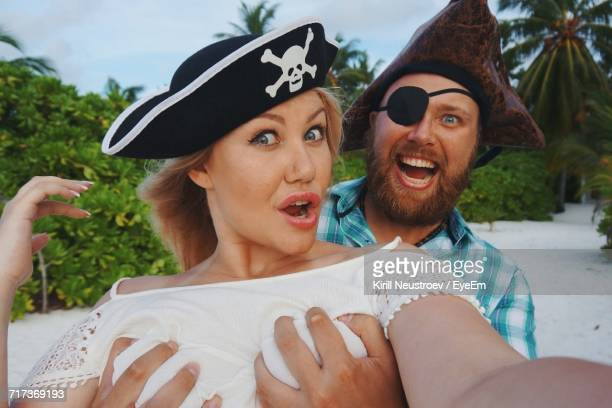 Pirate Pressing Breasts Of Woman At Beach