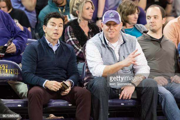 Pirate Radio host Troy Dreyfus and former Greenville Mayor Allen Thomas sit courtside during a game between the East Carolina Pirates and the Wichita...