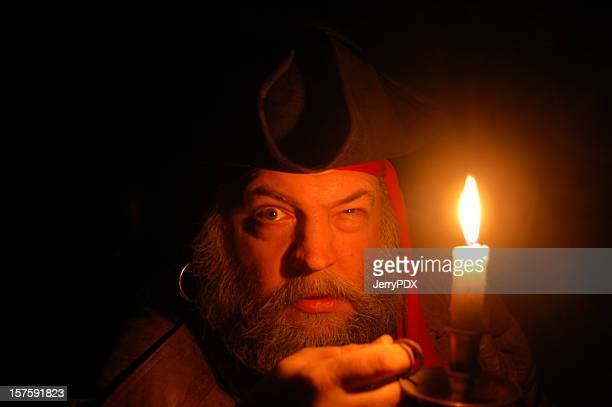 pirate searches by candlelight - pirates headshots stock pictures, royalty-free photos & images