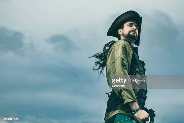 pirate standing in front of the storm. fantasy - period costume stock pictures, royalty-free photos & images