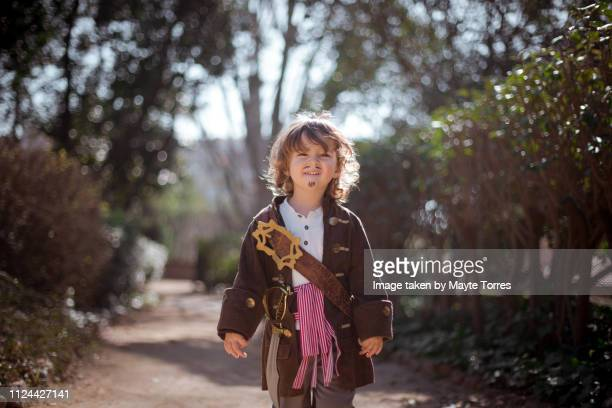 pirate toddler in the woods - autism awareness stock pictures, royalty-free photos & images