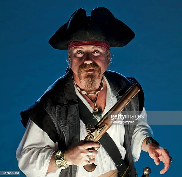 pirate with pistol, close-up. - pirates headshots stock pictures, royalty-free photos & images