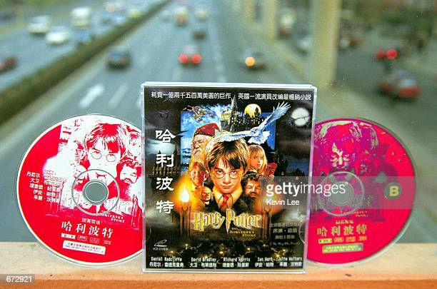 A pirated copy of the movie Harry Potter and the Sorcerer's Stone which were purchased in a shop of Beijing on are display November 22 2001 in China...