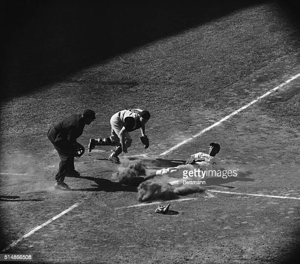 Pirates catcher puts the tag on Ernie Banks at the plate after the Cubs shortstop tried to score from first on a double