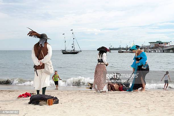 Pirates having fun on the beach at Pirate Invasion festival