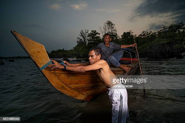 Pirates Henry Brea pushes a boat out of a mangrove swamp where they hide before planning pirate attacks and ambushes on the Strait of Malacca. 585...