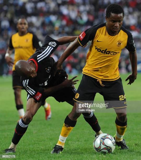 Pirates midfielder Dikgang Mabalane and Chiefs midfielder David Mathebula during the Absa Premiership match between Orlando Pirates and Kaizer Chiefs...