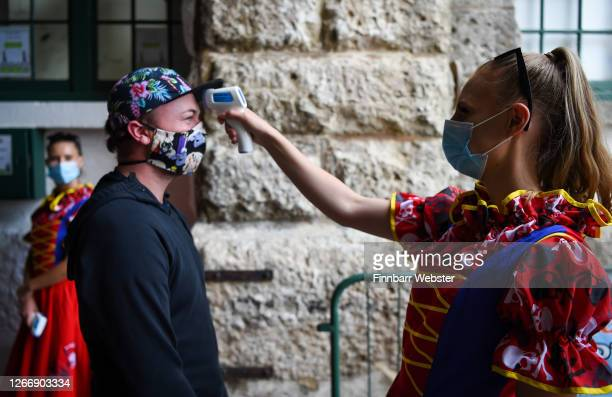Pirates of the Pavilion cast members check the temperature of the audience on arrival before the performance at The Nothe Fort on August 17 2020 in...