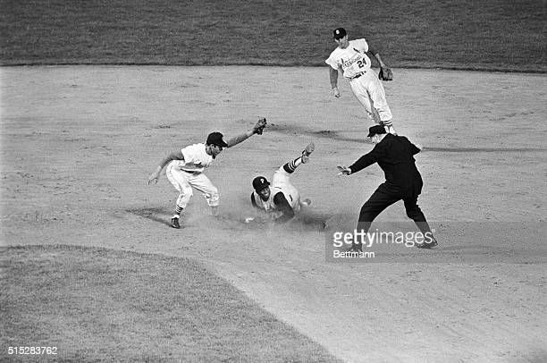 Pirates right fielder Roberto Clemente steals 2nd base safely in 4th inning of the CardsPirates game here 4/18 Clemente beat the throw to 2B Julian...