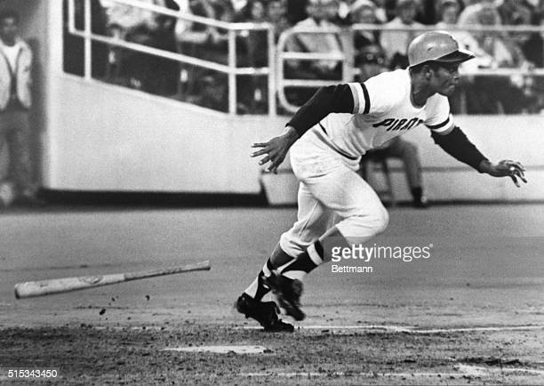 Pirates' Roberto Clemente drops his bat as he heads for first base during the first inning of the PiratesMets game in Pittsburgh 9/29 He reached...