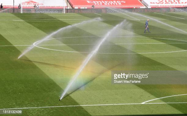 Pirch watering at Emirates stadium before the Premier League match between Arsenal and Fulham on April 18, 2021 in London, England. Sporting stadiums...
