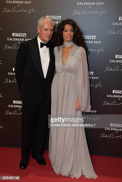 Pirelli CEO Marco Tronchetti Provera and his wife Italian model Afef Jnifen pose during a photocall ahead of a gala dinner held for the international...