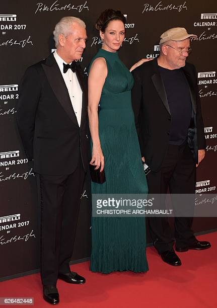 Pirelli CEO Marco Tronchetti Provera US actress Uma Thurman and German photographer Peter Lindbergh pose during a photocall ahead of a gala dinner...