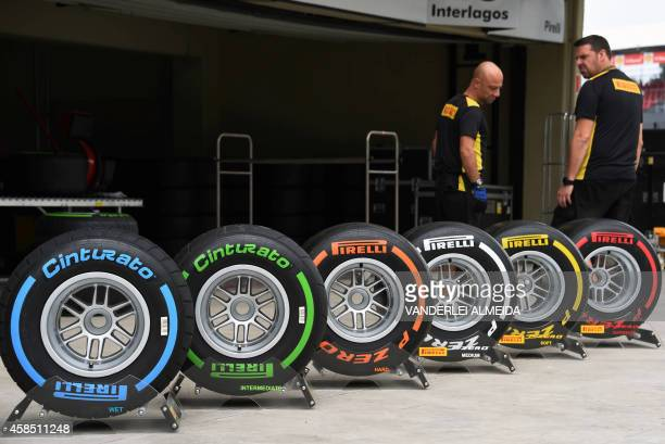 A Pirelli technician checks the tires at the Interlagos racetrack in Sao Paulo Brazil on November 6 2014 three days ahead of the Brazil Formula One...