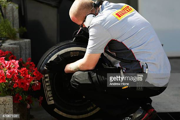 Pirelli technician worls on tyres during day two of Formula One Winter Testing at the Bahrain International Circuit on February 20 2014 in Bahrain...