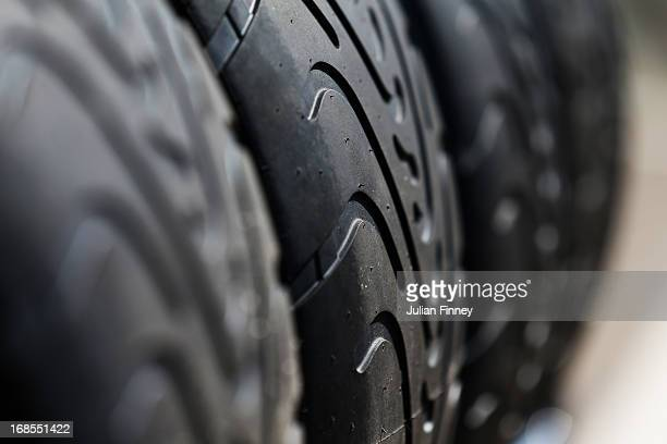 Pirelli tyres are stacked in the paddock following qualifying for the Spanish Formula One Grand Prix at the Circuit de Catalunya on May 11 2013 in...
