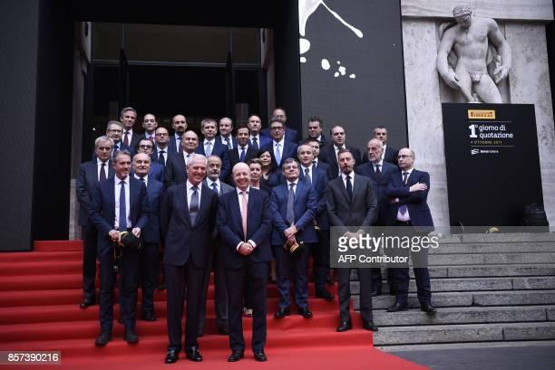 Pirelli's Executive Vice Chairman Marco Tronchetti Provera and CEO of Borsa Italiana Raffaele Jerusalmi pose during a ceremony to mark the comeback...