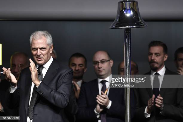 Pirelli's Executive Vice Chairman Marco Tronchetti Provera applauds after ringing the bell of Milan's stock exchange to mark the return of Italian...