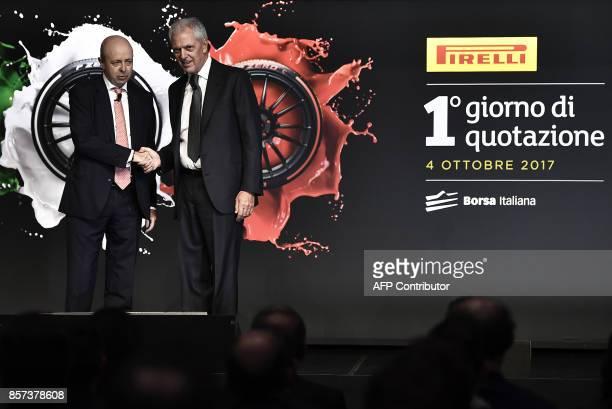 Pirelli's Executive Vice Chairman Marco Tronchetti Provera shakes hands with CEO of Borsa Italiana Raffaele Jerusalmi during a ceremony to mark the...