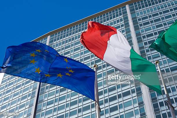 pirellone skyscraper in milan with italian and european flags - italian flag stock pictures, royalty-free photos & images