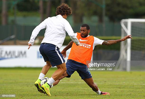 Pires Ribeiro Dodo competes with Yann M Vila FC Internazionale training session at the club's training ground on September 3 2014 in Como Italy