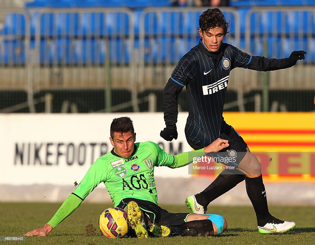 Pires Ribeiro Dodo (R) of FC Internazionale Milano competes for the ball during FC Internazionale training session at the club's training ground on February 11, 2015 in Como, Italy.