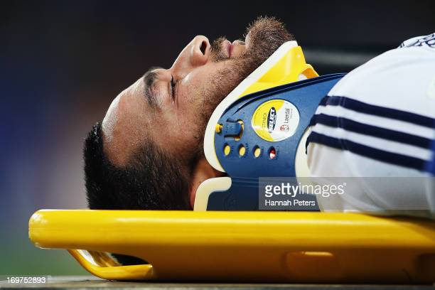 Piri Weepu of the Blues is taken off injured during the round 16 Super Rugby match between the Highlanders and the Blues at Forsyth Barr Stadium on...