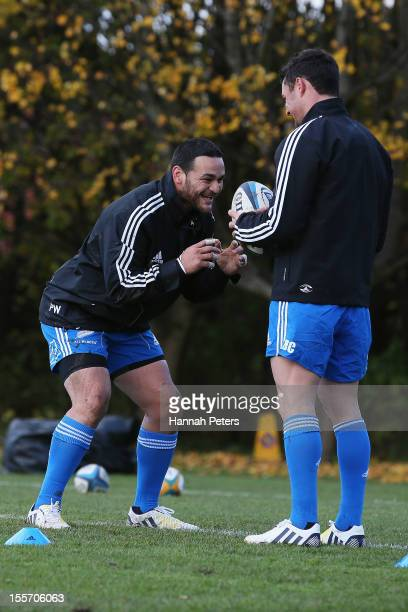 Piri Weepu runs through drills with Daniel Carter of the All Blacks during a training session at Peffermill University on November 7 2012 in...