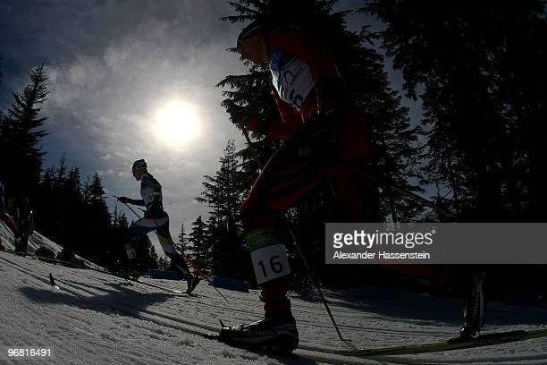 Pirjo Muranen of Finland and Alena Prochazkova of Slovakia compete during the Women's Individual Sprint C on day 6 of the 2010 Vancouver Winter...