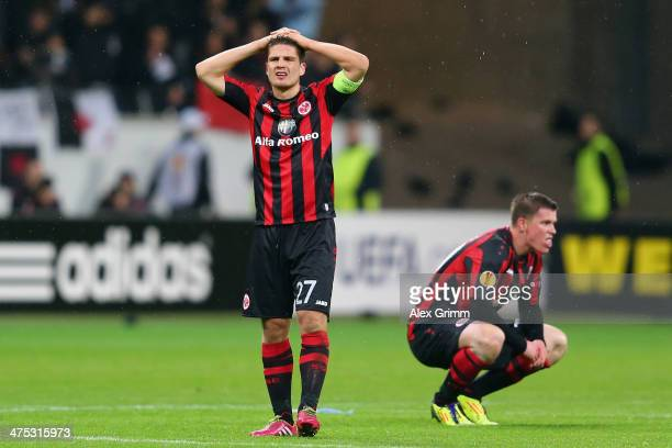 Pirmin Schwegler and Alexander Madlung of Frankfurt react after the UEFA Europa League Round of 32 second leg match between Eintracht Frankfurt and...