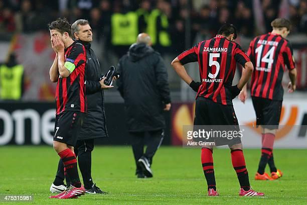 Pirmin Schwegler Carlos Zambrano and Alexander Meier of Frankfurt react after the UEFA Europa League Round of 32 second leg match between Eintracht...