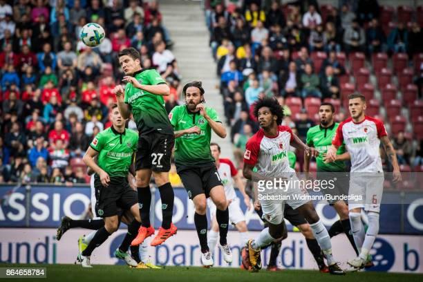 Pirmin Schwegler Martin Harnik of Hannover 96 jump for a header during the Bundesliga match between FC Augsburg and Hannover 96 at WWKArena on...