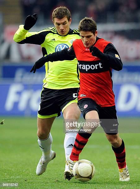 Pirmin Schwegler of Frankfurt battles for the ball with Edin Dzeko of Wolfsburg during the Bundesliga match between Eintracht Frankfurt and VFL...
