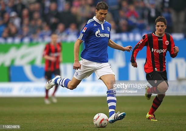 Pirmin Schwegler of Frankfurt follows Angelos Charisteas of Schalke during the Bundesliga match between FC Schalke 04 and Eintracht Frankfurt at...