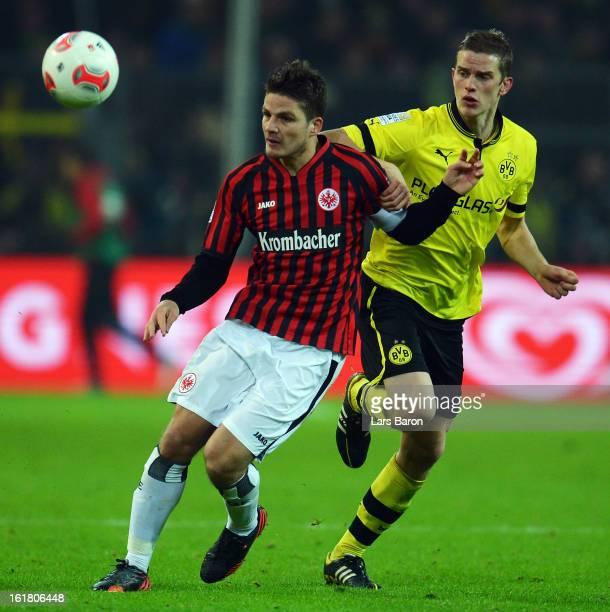 Pirmin Schwegler of Frankfurt is challenged by Sven Bender of Dortmund during the Bundesliga match between Borussia Dortmund and Eintracht Frankfurt...