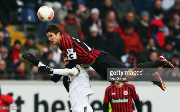 Pirmin Schwegler of Frankfurt outjumps Tomas Pekhart of Nuernberg during the Bundesliga match between Eintracht Frankfurt and 1 FC Nuernberg at...