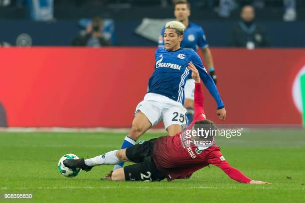 Pirmin Schwegler of Hannover and Amine Harit of Schalke battle for the ball during the Bundesliga match between FC Schalke 04 and Hannover 96 at...