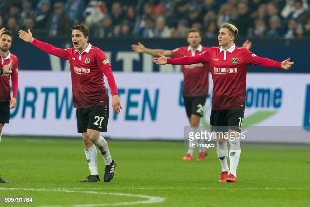 Pirmin Schwegler of Hannover and Felix Klaus of Hannover gesture during the Bundesliga match between FC Schalke 04 and Hannover 96 at VeltinsArena on...
