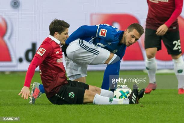 Pirmin Schwegler of Hannover and Marko Pjaca of Schalke battle for the ball during the Bundesliga match between FC Schalke 04 and Hannover 96 at...